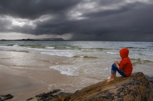 Girl sitting on rock, Morar, Inverness-shire, Scotland, UK